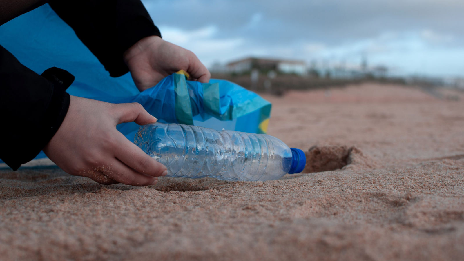 person-holding-clear-plastic-bottle-3480494
